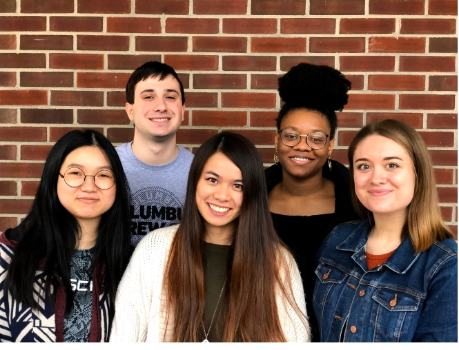 five smiling student research assistants